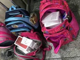 为吃麦当劳!深圳10名跨境学童帮带210台手机过关